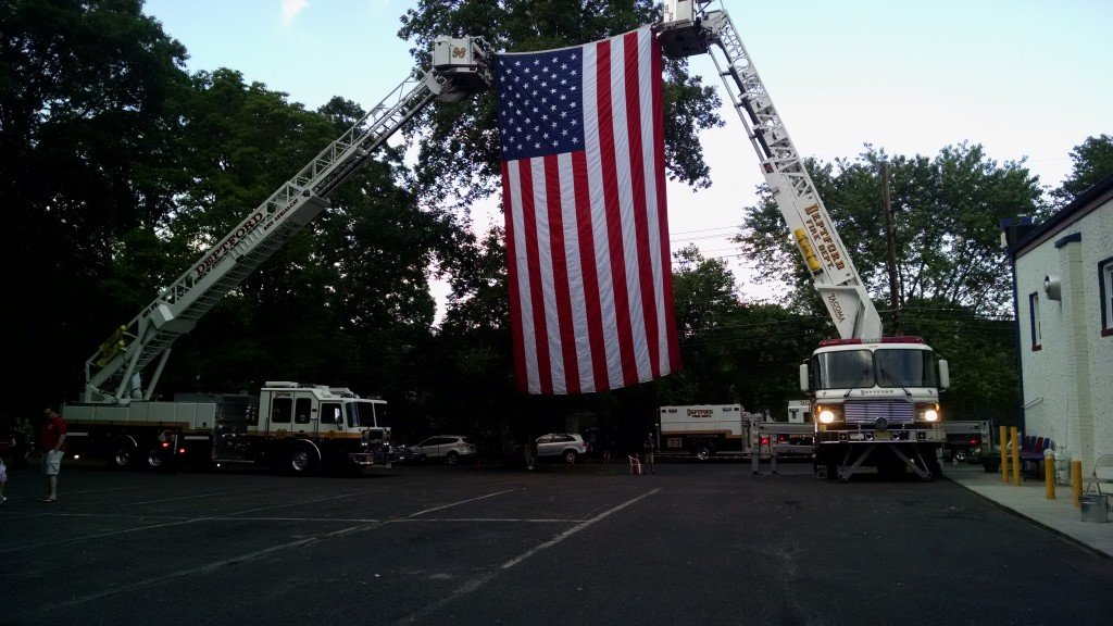 Ladder 926 Flies American Flag with Ladder 936 at VFW Post 2174