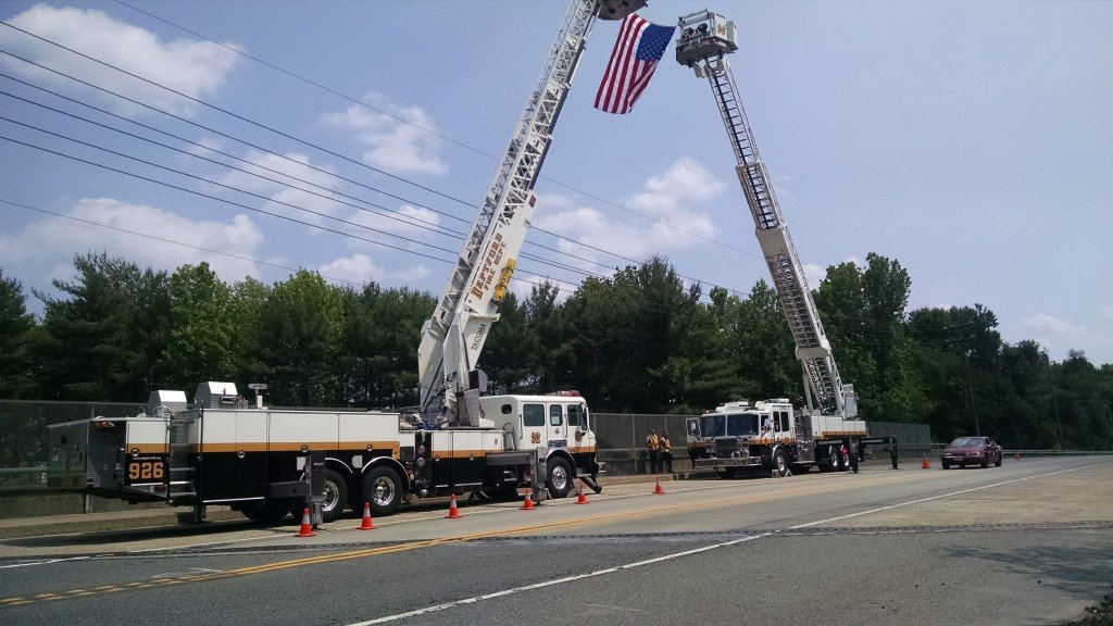 Ladder 926 Flies the American Flag in Support of Woolwich FC