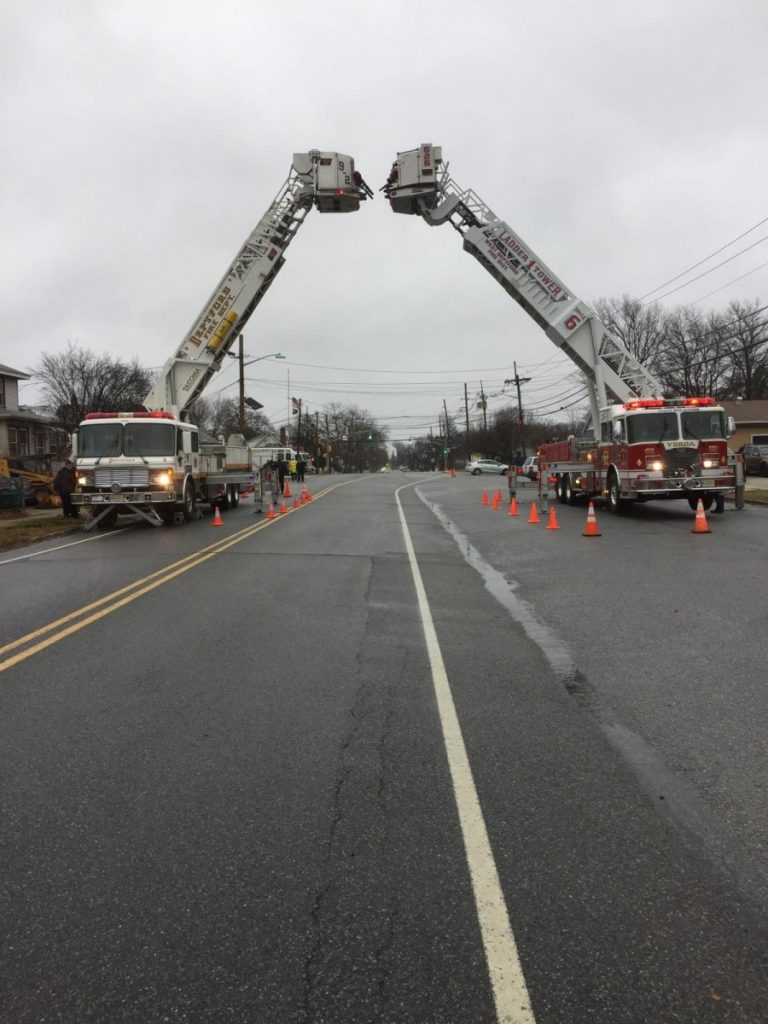 Ladder 926 Assists With Ladder Arch for Funeral at National Park Fire Dept